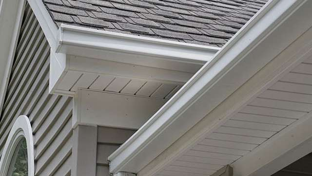 Roof with painted soffet and gutters featured